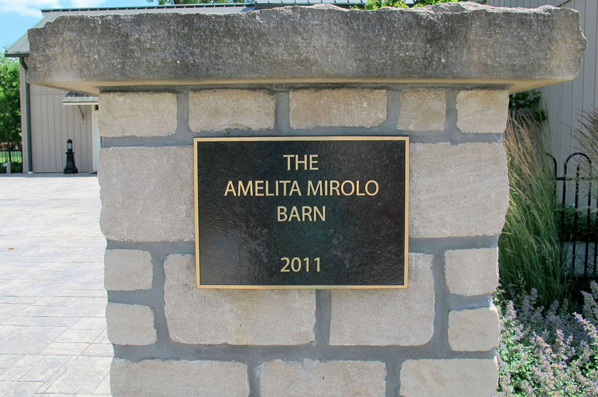 Amelita Mirolo Pillar Sign